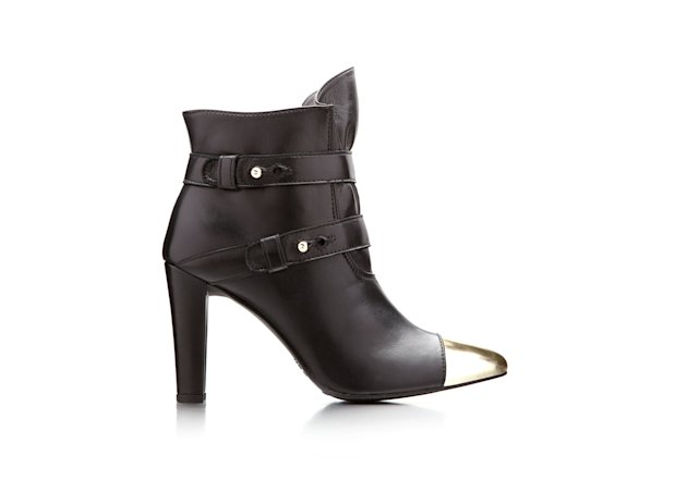 This product image released by Stuart Weitzman shows a gold metallic cap-toe black multi-strap ankle boot co-designed by actress-model Brooklyn Decker for a special Stuart Weitzman collection to help raise money for ovarian cancer research. (AP Photo/Stuart Weitzman)