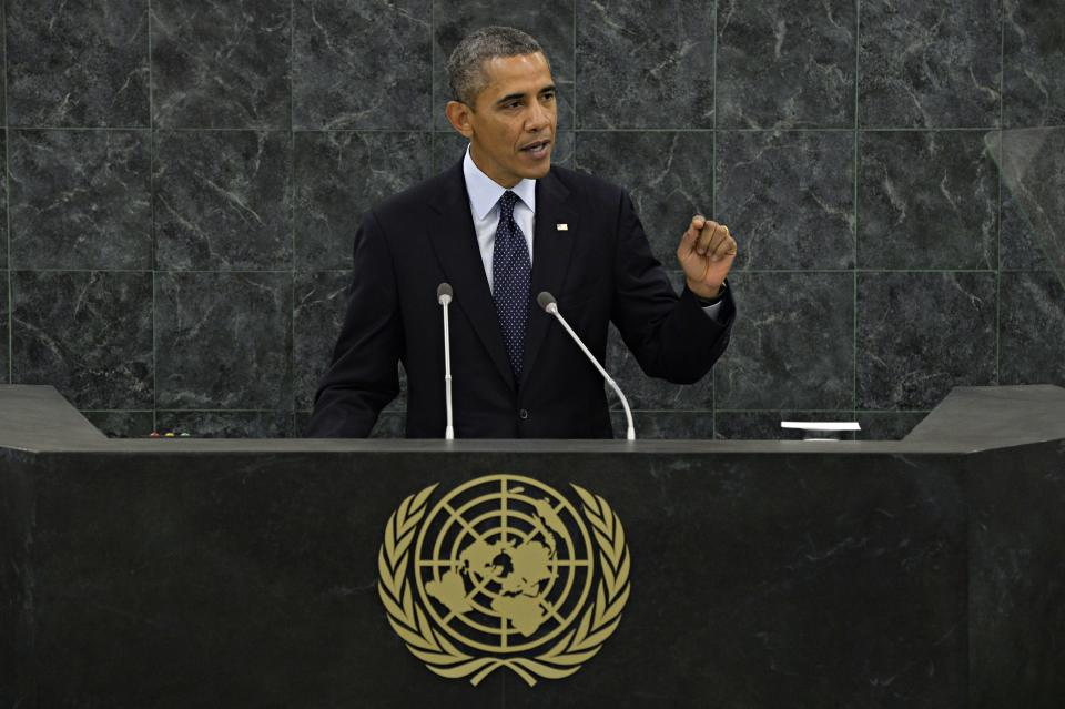 U.S. President Barack Obama gestures as he speaks during his address to the 68th Session of the United Nations General Assembly on Tuesday Sept. 24, 2013. (AP Photo/Andrew Burton,Pool)