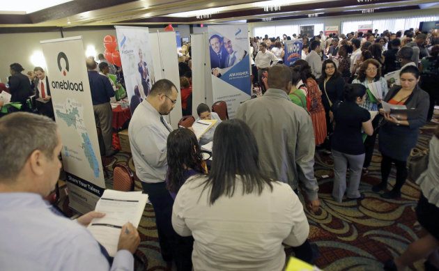 FILE - In this Wednesday, Aug. 14, 2013 file photo, job seekers check out companies at a job fair in Miami Lakes, Fla. The Labor Department reports on the number of Americans who applied for unemployment benefits on Thursday, Oct. 3, 2013. (AP Photo/Alan Diaz, File)