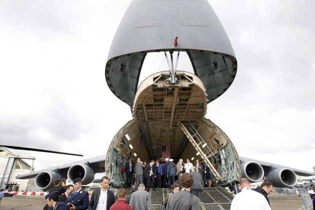 Visitors in front of the US Air Force Galaxy at the Paris Air Show, at le Bourget airport, north of Paris, Tuesday June 21, 2011. Along with 150 aircraft display, many of them taking part in the daily