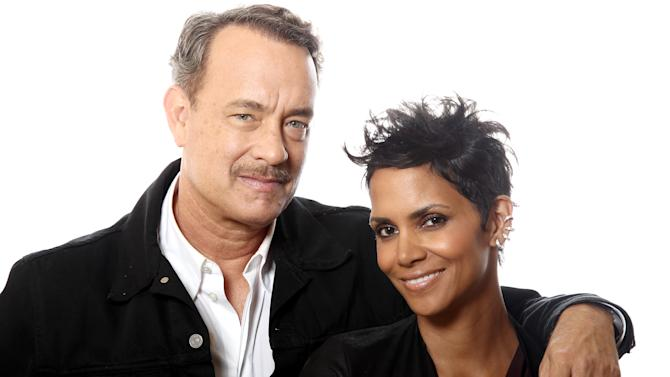 """In this Oct. 14, 2012 photo, actors Tom Hanks, left, and Halle Berry, from the upcoming film """"Cloud Atlas,"""" pose for a portrait in Beverly Hills, Calif. The stars of """"Cloud Atlas,"""" along with British author David Mitchell, who wrote the novel that inspired the genre-bending epic about souls returning and intertwining over the centuries, shared their beliefs and disbeliefs about reincarnation as the film heads to U.S. theaters Oct. 26, 2012. Hanks himself doesn't buy into reincarnation, while Berry, Whishaw, Mitchell, Sarandon and co-stars Hugo Weaving and Jim Sturgess either believe or at least think it's possible that souls come back for an encore. (Photo by Matt Sayles/Invision/AP)"""
