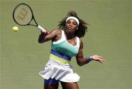 Williams hits a return to Sharapova in their women's singles final match at the Sony Open tennis tournament in Key Biscayne