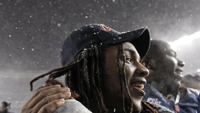 Syracuse running back Prince-Tyson Gulley (23) celebrates with a teammate after Syracuse defeated West Virginia 38-14 in the Pinstripe Bowl NCAA college football game at Yankee Stadium in New York, Saturday, Dec. 29, 2012.  (AP Photo/Kathy Willens)