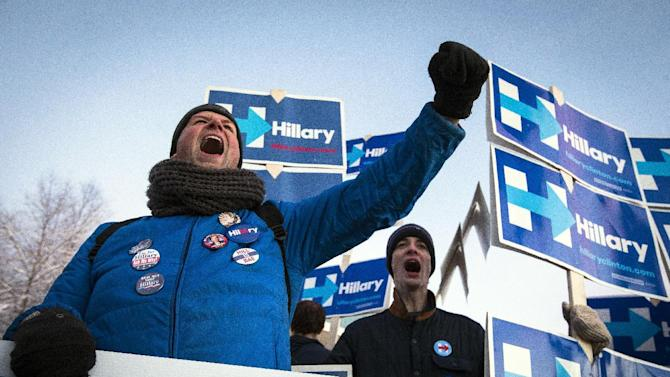 Supporters of Democratic presidential candidate Hillary Clinton cheer while holding signs outside the Verizon Wireless Center before the 2016 McIntyre Shaheen 100 Club Celebration, Friday, Feb. 5, 2016, in Manchester, N.H. (AP Photo/John Minchillo)