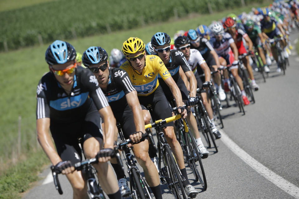 Bradley Wiggins of Britain, wearing the overall leader's yellow jersey, rides in the pack during the 15th stage of the Tour de France cycling race over 158.5 kilometers (98.5 miles) with start in Samatan and finish in Pau, France, Monday July 16, 2012. (AP Photo/Laurent Cipriani)