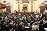 A general view of the first session of the Egyptian parliament in Cairo on July 10. Egypt&#39;s Supreme Constitutional Court froze a presidential decree reinstating the Islamist-led parliament, hours after the lower house convened in defiance of the judiciary and military