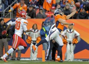 Broncos take top spot with 38-3 win over Chiefs