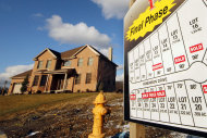 <p>               This Jan. 18, 2012 photo shows a new home in a development in Pleasant Hills, Pa. Fewer people bought new homes in December, making 2011 the worst sales year on record. (AP Photo/Gene J. Puskar)
