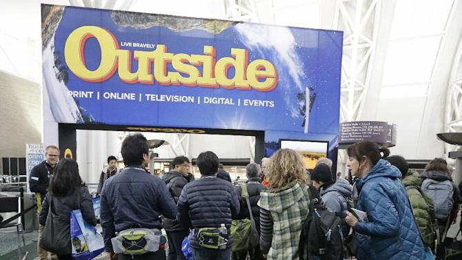 FILE - In this Jan. 23, 2013 file photo, people enter the Outdoor Retailer Show in Salt Lake City. In Utah, the Outdoor Industry Association pressured the state's Republican governor to treat outdoor recreation seriously by threatening to pull a lucrative trade show out of Salt Lake City. They have helped fund nonprofits that lobby for increased land preservation, sometimes butting heads with energy groups seeking to drill on federal lands. (AP Photo/Rick Bowmer, File)