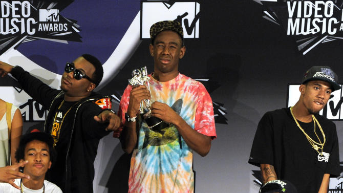 FILE - In this Aug. 28, 2011 file photo, Tyler, The Creator, center, holds the award for best new artist as he poses with other members of Odd Future at the MTV Video Music Awards in Los Angeles. New Zealand immigration authorities have banned Los Angeles rappers Odd Future from entering the country after deciding they pose a threat to public order. Tyler, The Creator vented his frustration on Twitter on Thursday, Feb 13, 2014. (AP Photo/Chris Pizzello, File)
