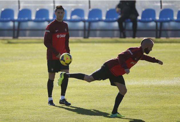 Portugal's Cristiano Ronaldo watches his teammate Raul Meireles during a training session in Obidos