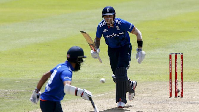 England's Hales and Ali run between wickets during the One Day International Cricket match against South Africa in Cape Town
