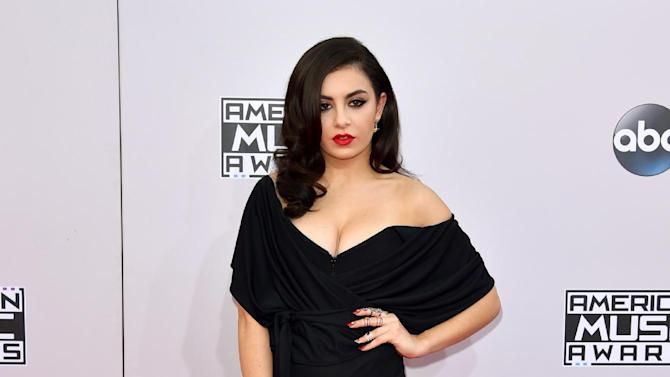 Charli XCX arrives at the 42nd annual American Music Awards at Nokia Theatre L.A. Live on Sunday, Nov. 23, 2014, in Los Angeles. (Photo by John Shearer/Invision/AP)