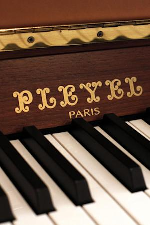 A Pleyel piano is displayed in a piano store, in Paris, Saturday, Nov. 16, 2013. Gone are its glory days, when Chopin composed concertos on its pianos. France's Pleyel piano maker is shutting its doors, unable to keep up with cheaper and more agile competition. (AP Photo/Thibault Camus)