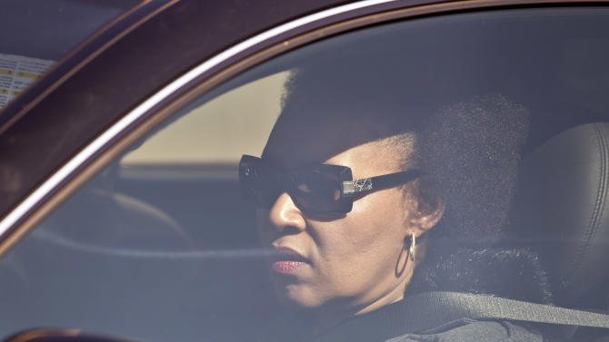 Daughter Zenani Dlamini arrives by car at the Mediclinic Heart Hospital where former South African President Nelson Mandela is being treated, in Pretoria, South Africa Wednesday, June 12, 2013. (AP Photo/Ben Curtis)