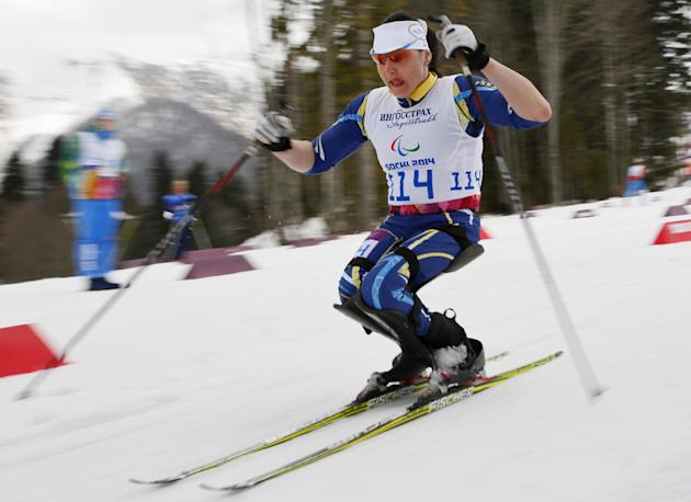 Lyudmyla Pavlenko of Ukraine races to win the ladies 12km cross country ski, sitting event at the 2014 Winter Paralympic, Sunday, March 9, 2014, in Krasnaya Polyana, Russia