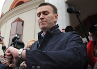 Russian protest leader Alexei Navalny outside court in the provincial city of Kirov on April 17, 2013. The 36-year-old lawyer with bright blue eyes and the confident ability to rally crowds has rattled the Kremlin with his rapid emergence as a tireless anti-corruption campaigner and his openly declared ambition to stand as president