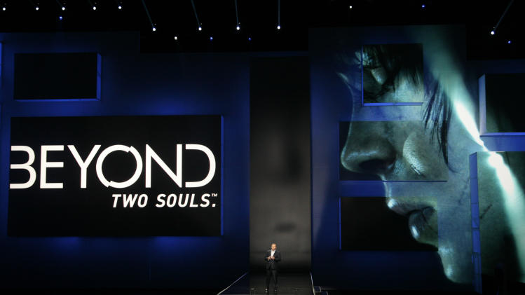 "Jack Tretton, President and CEO of Sony Computer Entertainment America, introduces the game ""Beyond Two Souls"" featuring Ellen Page at the Sony Electronic Entertainment Expo (E3) news conference in Los Angeles, Monday, June 4, 2012. (AP Photo/Jason Redmond)"