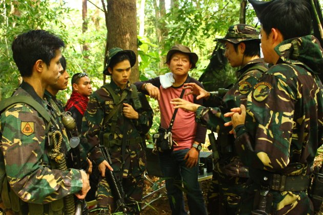 "Director Chito Roño with his actors, including Martin Escudero, on the set of ""Shake, Rattle and Roll XIV (SRR): The Invasion"" (Photo courtesy of Regal Films)"