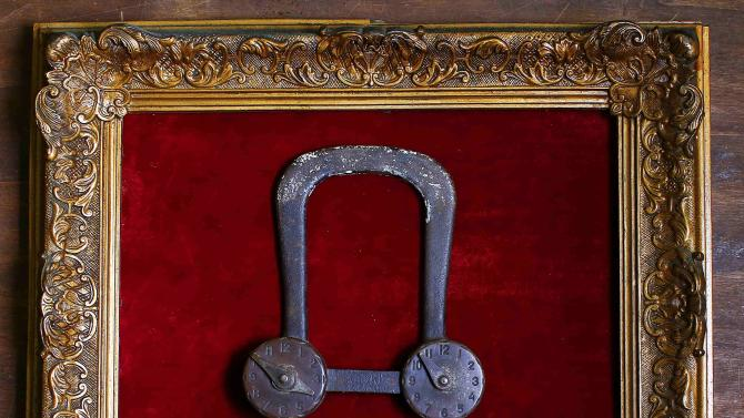 A 19th century bicycle safety lock is displayed in an old frame in the Museum of Domenico Agostinelli in Dragona