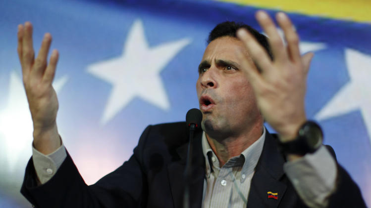 Opposition leader Henrique Capriles gestures during a press conference in Caracas, Venezuela, Sunday, March 10, 2013.  Capriles announced he will run in election, scheduled for April 14th, to replace late President Hugo Chavez, who died of cancer on March 5. (AP Photo/Rodrigo Abd)