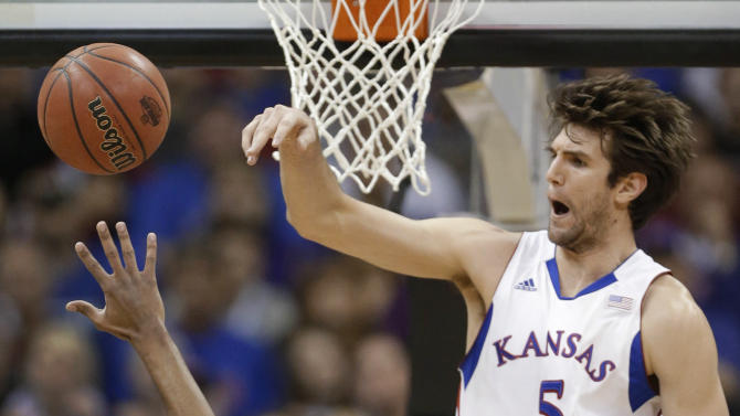 Kansas center Jeff Withey (5) blocks a shot by Kansas State guard Shane Southwell (1) during the first half of an NCAA college basketball game for the Big 12 men's tournament title Saturday, March 16, 2013, in Kansas City, Mo. (AP Photo/Orlin Wagner)