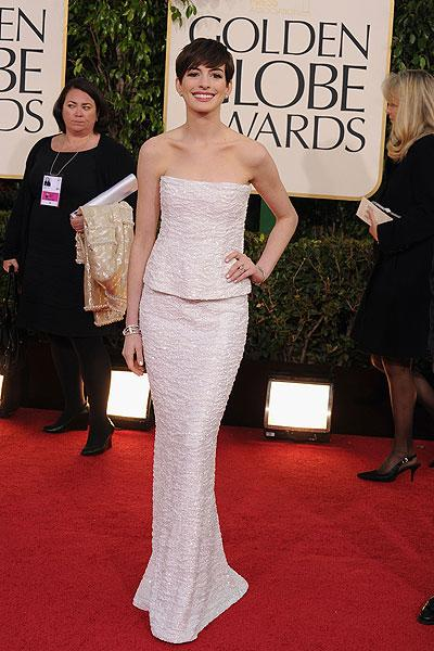 Anne Hathaway: The 'Les Miserables' star and Golden Globe nominee is perfection in a glittering snow white Chanel look. But wait, she's not wearing a dress, she's wearing separates! It's a simple but trendy look that goes well with her adorable pixie cut. (Photo by Steve Granitz/WireImage)