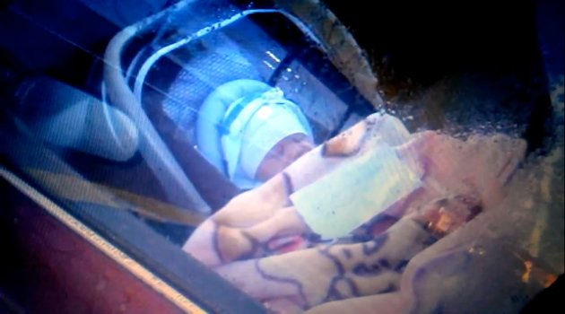 This picture of a New Zealand newborn baby left alone in a locked car, with an accompanying note, went viral online over the past two days. (Screengrab from video)