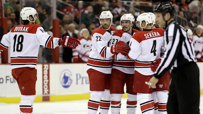 Hurricanes score 3 times in 2nd to beat Devils 4-3
