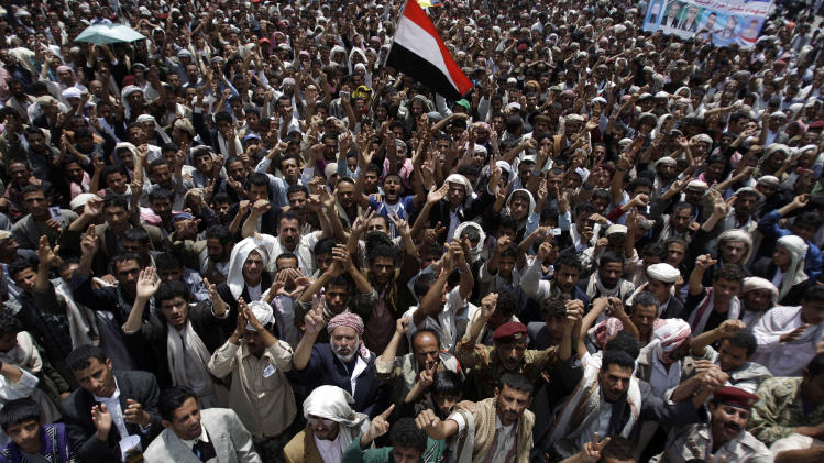 Protestors chant slogans during a demonstration demanding the resignation of Yemeni President Ali Abdullah Saleh in Sanaa, Yemen, Sunday, Sept. 11, 2011. (AP Photo/Hani Mohammed)