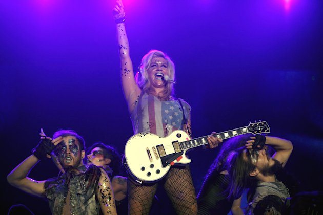 FILE - In this Sept. 11, 2011 file photo, U.S. pop singer Ke$ha performs during the Rock in Rio music festival in Rio de Janeiro, Brazil. MTV announced late Tuesday, Jan. 29, 2013, that the pop singer will debut a documentary series, Ke$ha: My Crazy Beautiful Life, in April. (AP Photo/Silvia Izquierdo, File)