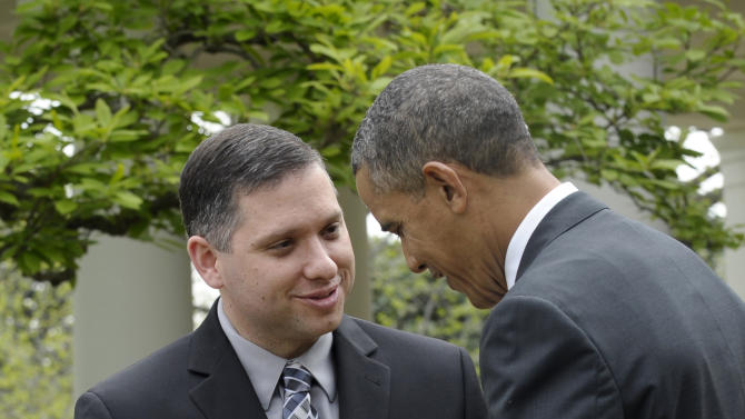 President Barack Obama presents 2013 National Teacher of the Year Jeff Charbonneau, who teaches at Zillah High School in Zillah, Wash., with his award during a ceremony in the Rose Garden of the White House in Washington, Tuesday, April 23, 2013. (AP Photo/Susan Walsh)