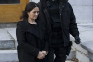 Tooba Yahya is led away from the Frontenac County courthouse in Kingston, Ontario, Sunday, Jan. 29, 2012, after being found guilty of first degree murder. A jury took 15 hours to find Shafia, 58, his wife Tooba Yahya, 42, and their son Hamed, 21, each guilty of four counts of first-degree murder in a case so shocking it has riveted Canadians from coast to coast. (AP Photo/The Canadian Press, Graham Hughes)