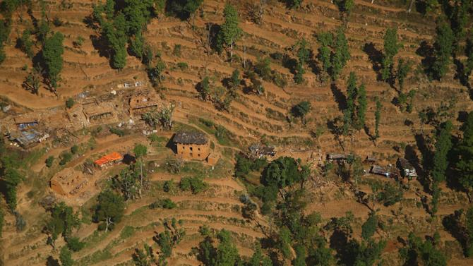Collapsed and damaged houses are pictured from a helicopter after last week's earthquake at Sindhupalchok District