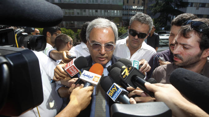 Soccer Serie A league President  Maurizio Beretta answers reporters questions as he arrives at the 'Lega Calcio' headquarter in Milan, Italy, Friday, Aug. 19, 2011. Speaking before a meeting Beretta said he is confident that a strike threatened by the players to delay the start of the season can be avoided. The players have said that if a new collective contract is not signed before the Aug. 27-28 start of the season, they will strike. (AP Photo/Luca Bruno)