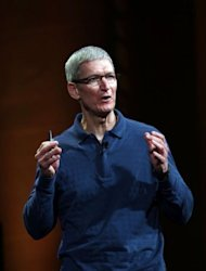 Apple CEO Tim Cook speaks during Apple's special event to introduce the iPad Mini at the California Theatre in San Jose, California. Apple introduced the iPad mini, confident that a smaller version of its beloved tablet computer will trump lower-priced offerings by rivals Amazon, Google and Samsung