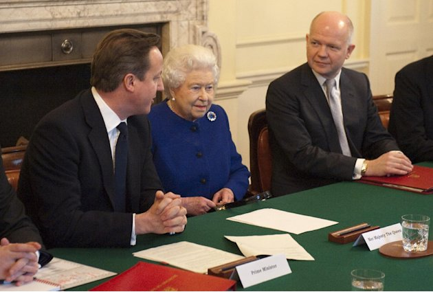Britain's Queen Elizabeth II, center,  attends a cabinet meeting sat between British Prime Minister David Cameron, left, and Foreign Secretary William Hague in 10 Downing Street in London, Tuesday, De