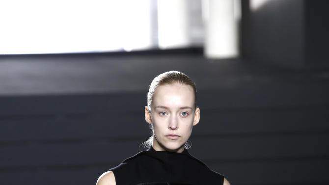 A model wears a creation for American designer Rick Owens' fall-winter 2015-2016 ready to wear fashion collection, presented at Paris fashion week, Paris, France, Thursday, March 5, 2015. (AP Photo/Christophe Ena)