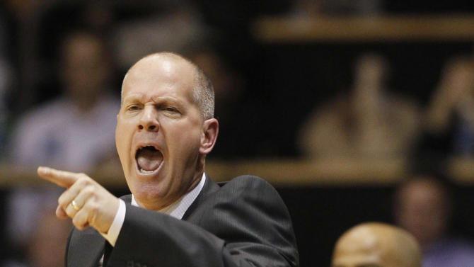 Colorado head coach Tad Boyle directs his squad against Arizona in the second half of Colorado's 71-58 victory in an NCAA college basketball game in Boulder, Colo., Thursday, Feb. 14, 2013. (AP Photo/David Zalubowski)