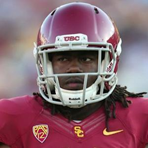 USC 'vetting' injured football player's alleged heroics
