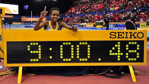 Ethiopia's Genzebe Dibaba poses after running a world record time in the women's two miles (AFP)
