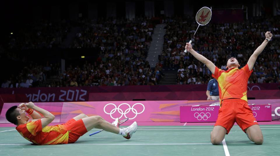China's Fu Haifeng, left, and Cai Yun celebrate after beating Koo Kien Keat and Tan Boon Heong, of Malaysia, in a men's doubles badminton semifinal match at the 2012 Summer Olympics, Saturday, Aug. 4, 2012, in London. (AP Photo/Andres Leighton)