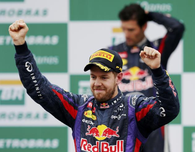 Sebastian Vettel of Germany celebrates his win in front of Mark Webber of Australia after the Brazilian F1 Grand Prix at the Interlagos circuit in Sao Paulo
