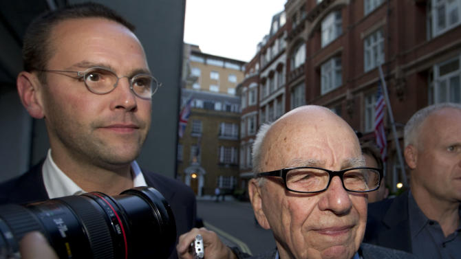 FILE - This Sunday July 10, 2011 file photo shows Chairman of News Corporation Rupert Murdoch, right, and his son James Murdoch, chief executive of News Corporation Europe and Asia arrive at his residence in central London. An influential group of British lawmakers say Rupert Murdoch is unfit to lead his global media empire, in a scathing report that says his company misled Parliament about the scale of phone hacking at one of its tabloids. Parliament's cross-party Culture, Media and Sport committee said Tuesday May 1, 2012, that News International, the British newspaper division of Murdoch's News Corp., had deliberately ignored evidence of malpractice, covered up evidence and frustrated efforts to expose wrongdoing. (AP Photo/Sang Tan, file)