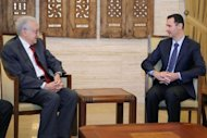 Syrian President Bashar al-Assad (R) meets with peace envoy Lakhdar Brahimi in Damascus. Brahimi has warned after meeting Assad that the worsening conflict in Syria poses a threat to the region and the world at large