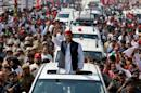 Akhilesh Yadav waves at his supporters during a Rath Yatra, or a chariot journey, as part of an election campaign in Lucknow