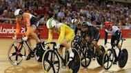 Anna Meares of Australia competes next to Willy Kanis of the Netherlands during the women's keirin qualifying