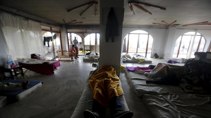 A Congolese immigrant sleeps in a deserted hotel on the Greek island of Kos