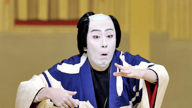 "In this photo taken Sept. 2, 2011, Kabuki actor Kanzaburo Nakamura performs in a dance drama titled ""Omatsuri"" at the New Kabukiza theater in Osaka, Japan. Kanzaburo, who helped boost the popularity of the traditional Japanese art form, died Wednesday, Dec. 5, 2012. He was 57. (AP Photo/Kyodo News) NO ARCHIVE, ONE TIME USE ONLY, JAPAN OUT, MANDATORY CREDIT, NO LICENSING IN CHINA, FRANCE, HONG KONG, JAPAN AND SOUTH KOREA"