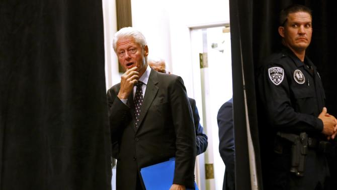 Former U.S. president Bill Clinton waits to be introduced during an early voting rally in Baton Rouge, Louisiana